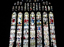 15th Century stained glass window on east wall All Saint's