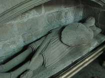 14th Century stone effigy of Madoc ap Llywelyn, attired in chain mail, with sword and shield All Saint's Church