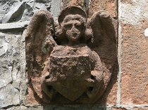 Angelic carved sandstone headstop St Mary's Church Pentraeth