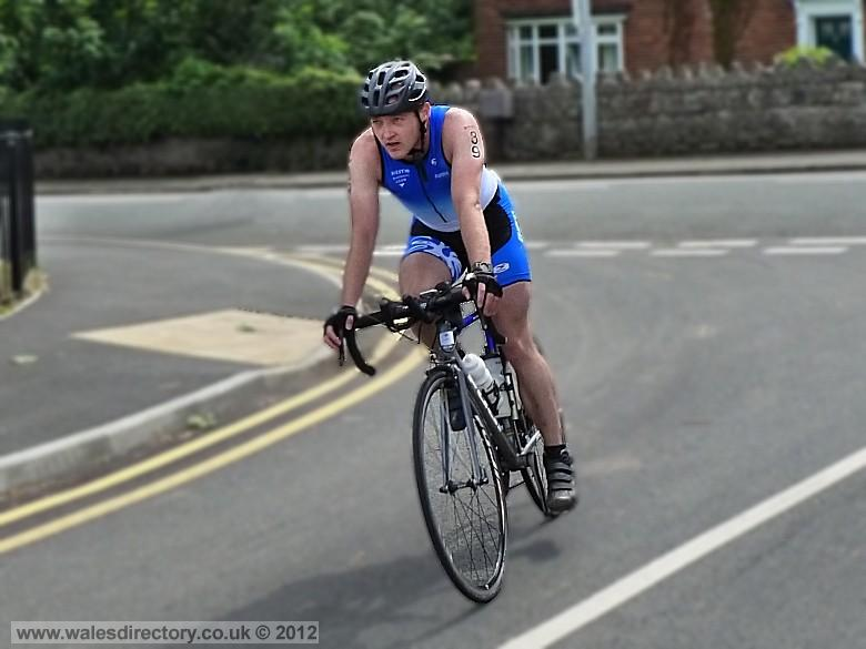 Enlarged picture of Cyclist in the  2012 Triathlon at Colwyn Bay